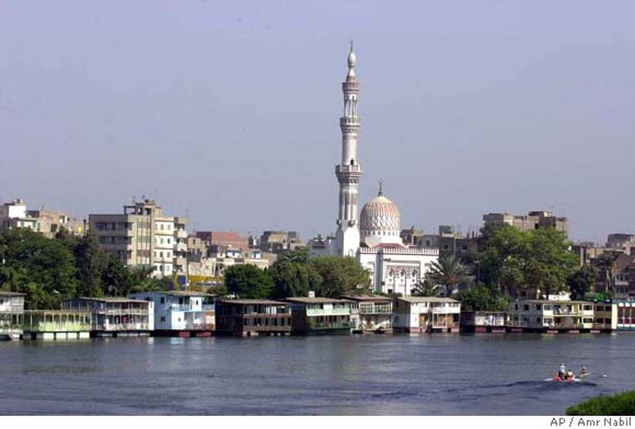 TRAVEL CAIRO HOUSEBOATS -- A general view of Cairo's Nile houseboats and the adjacent suburb of Kit Kat and its landmark mosque, Aug.31, 2002. Egypt's Nobel Prize laureate Naguib Mafhouz used the houseboats as the setting for his 1966 novel, Adrift on the Nile.(AP Photo/Amr Nabil)  Ran on: 06-10-2007  Although 85 percent of the Nile's water originates in Ethiopia, Egypt (above) uses 75 percent of it.  Ran on: 06-10-2007 Photo: Amr Nabil