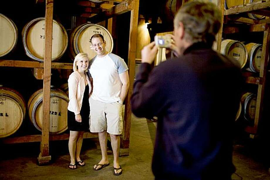 Bre and Erik Taylor, of Littleton, CO., have their picture taken by Michael Miller, of Burgess Cellars, in the tasting room, in St. Helena, CA, on Sunday, June 7, 2009. Photo: Lianne Milton