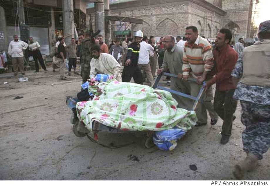 ###Live Caption:Iraqis remove the dead from the scene of suicide bombing in Karbala, 80 kilometers (50 miles) south of Baghdad, Iraq, Monday, March, 17, 2008. A female suicide bomber attacked a group of Shiite worshippers near a mosque in Karbala on Monday, killing at least 32 people and wounding 51, officials said. (AP Photo/ Ahmed Alhussainey)###Caption History:Iraqis remove the dead from the scene of suicide bombing in Karbala, 80 kilometers (50 miles) south of Baghdad, Iraq, Monday, March, 17, 2008. A female suicide bomber attacked a group of Shiite worshippers near a mosque in Karbala on Monday, killing at least 32 people and wounding 51, officials said. (AP Photo/ Ahmed Alhussainey)###Notes:###Special Instructions: Photo: AHMED ALHUSSAINEY