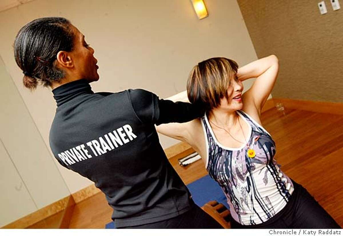 ###Live Caption:Cecily Guest, 40, left, is a Private Trainer helping Lilly Cook, 60, right, do a shoulder stretch at Sports Club LA/San Francisco, on Market St. in San Francisco, Calif. on Tuesday March 18, 2008. Photo by Katy Raddatz / San Francisco Chronicle###Caption History:Cecily Guest, 40, left, is a Private Trainer helping Lilly Cook, 60, right, do a shoulder stretch at Sports Club LA/San Francisco, on Market St. in San Francisco, Calif. on Tuesday March 18, 2008. Photo by Katy Raddatz / San Francisco Chronicle###Notes:exercise###Special Instructions:MANDATORY CREDIT FOR PHOTOG AND SAN FRANCISCO CHRONICLE/NO SALES-MAGS OUT