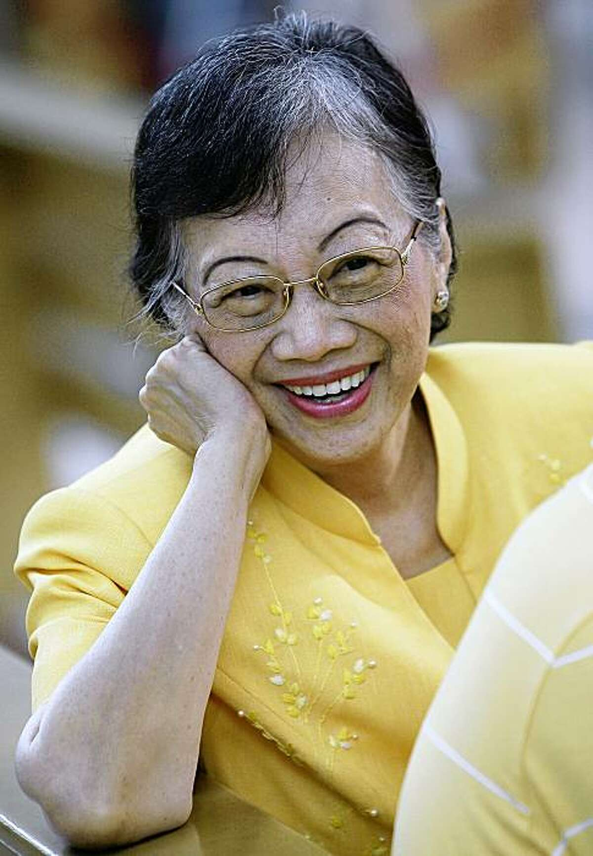 In this Sunday Aug. 17, 2008 file picture, cancer-stricken former Philippine President Corazon Aquino smiles to friends inside the church at the Ateneo de Manila University in suburban Quezon City, Philippines. Aquino, who swept away a dictator and then sustained democracy by fighting off seven coup attempts in six years, has died, her family said Friday, July 31, 2009. She was 76. (AP Photo/Aaron Favila)