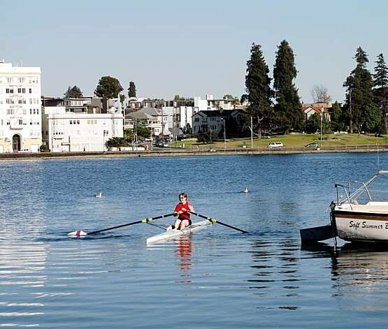 A rower arriving at the Sail Boat Club House.