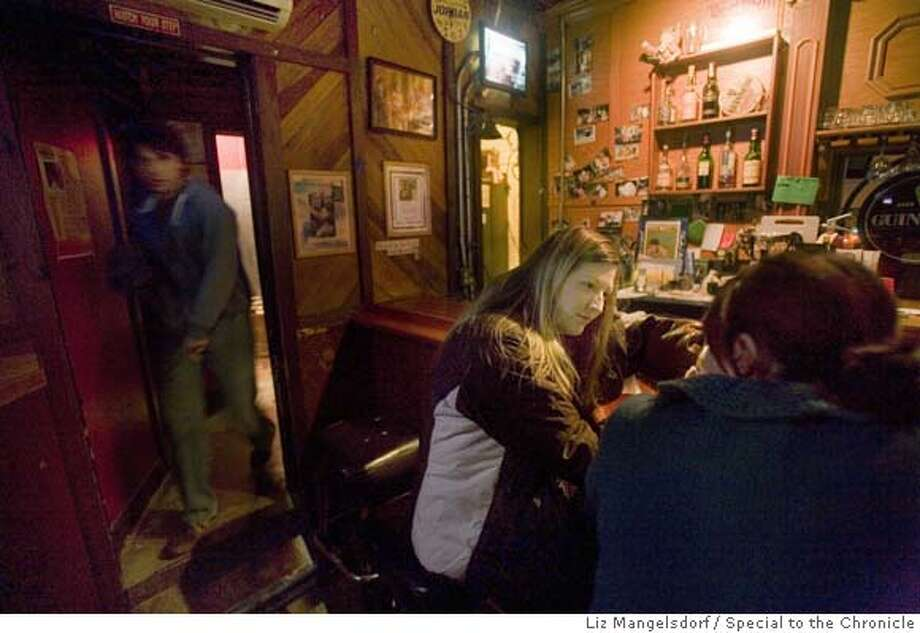 ###Live Caption:Dovre_129.cr2  Brian McElhatton's widow Meghan McElhatton, center, at the bar in the Dover Club on Valencia St. in San Francisco. The owner, Brian McElhatton died a few weeks ago, and we spend some time in the Irish bar.  Photo by Liz Mangelsdorf, Special to the Chronicle Event on 2/1/08 in San Francisco.###Caption History:Dovre_129.cr2  Brian McElhatton's widow Meghan McElhatton, center, at the bar in the Dover Club on Valencia St. in San Francisco. The owner, Brian McElhatton died a few weeks ago, and we spend some time in the Irish bar.  Photo by Liz Mangelsdorf, Special to the Chronicle Event on 2/1/08 in San Francisco.###Notes:###Special Instructions:MANDATORY CREDIT FOR PHOTOG AND SF CHRONICLE/NO SALES-MAGS OUT Photo: Liz Mangelsdorf