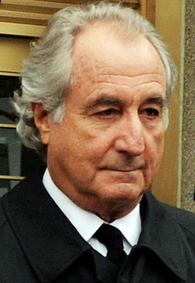 FILE - In this March 10, 2009 file photo, Bernard Madoff exits Manhattan federal court in New York. Madoff will get one last creature comfort before he is sentenced Monday,June 29, 2009 probably to serve out the rest of his days in prison. The judge has given him permission to don his own clothes for the hearing, rather than a jail uniform. (AP Photo/Louis Lanzano, File) Photo: Louis Lanzano, AP / ONLINE_CHECK