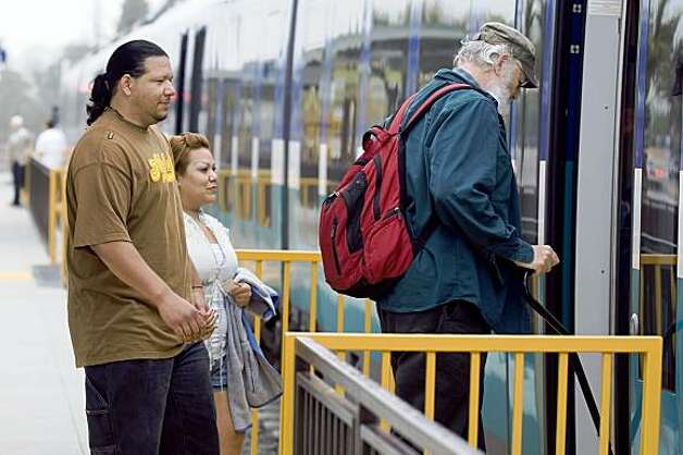 56786 Hector Veloz (L) boards the Sprinter light rail with his girlfriend Karina Cordova (C) in San Marcos, California on Friday, May 29, 2009. By JOSHUA GATES WEISBERG/SPECIAL TO THE CHRONICLE Photo: Joshua Gates Weisberg, Special To The Chronicle
