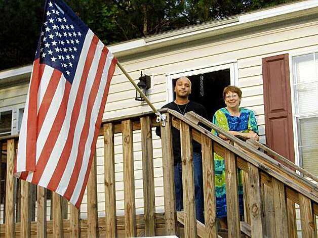 Mark Lyttle and his mother Jeanne Lyttle stand on her porch in Georgia after he returned home from being deported.  But we want to use just mark's picture as a mug. Photo: Courtesy Of Jacqueline Stevens