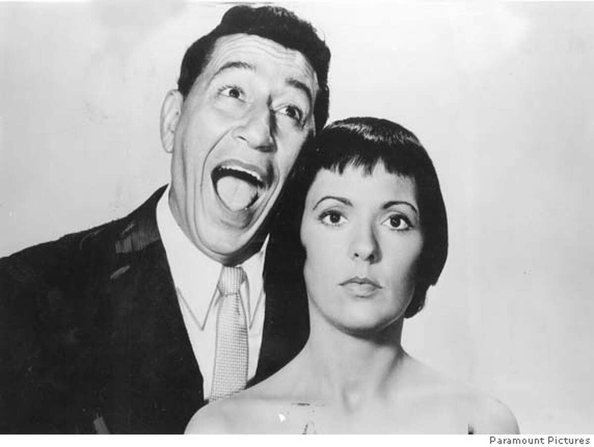 Keely Smith and Louis Prima publicity photo from Dot Record, a division of Paramount Pictures. The photo is dated 1959.