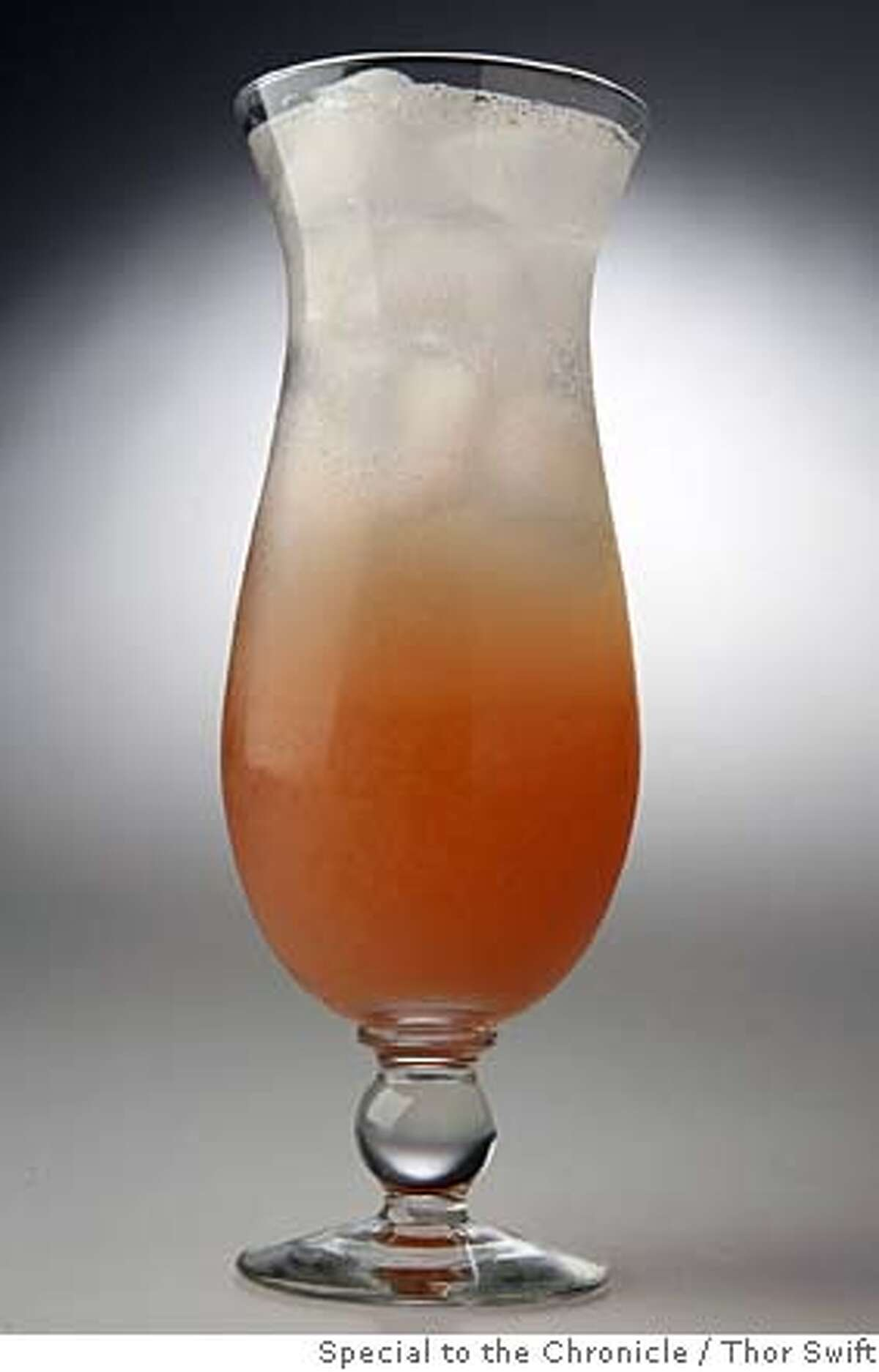 ###Live Caption:Singapore Sling coctail photographed Thursday, March 6, 2008 at the San Francisco Chronicle studio. Thor Swift For The San Francisco Chronicle###Caption History:Singapore Sling coctail photographed Thursday, March 6, 2008 at the San Francisco Chronicle studio. Thor Swift For The San Francisco Chronicle###Notes:###Special Instructions:38694