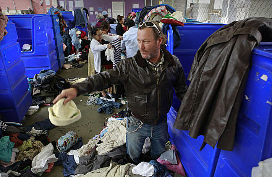 Asmir Ruznic, searches a bin at the Goodwill As-Is store near the corner of 11th and Mission streets, on Friday July 24, 2009 in San Francisco, Calif. The business has seen an increase in revenue of 38% through these recessionary times. Photo: Michael Macor, The Chronicle