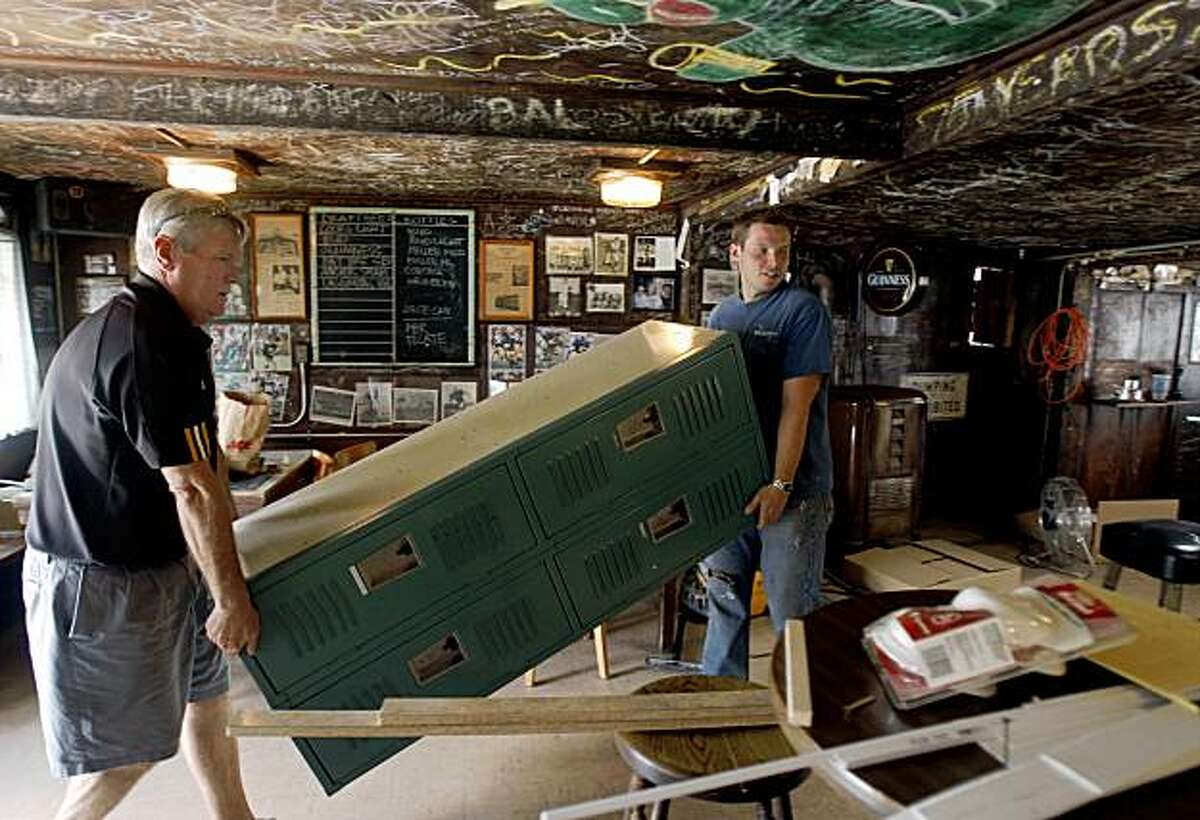 Mike Bowler (left) and his business partner Emil Peinert carry in lockers for employees at the Kingfish Pub in Oakland, Calif., on Wednesday, July 29, 2009. Bowler and Peinert will reopen Oakland's second oldest bar this weekend after it had been closed for over a year.