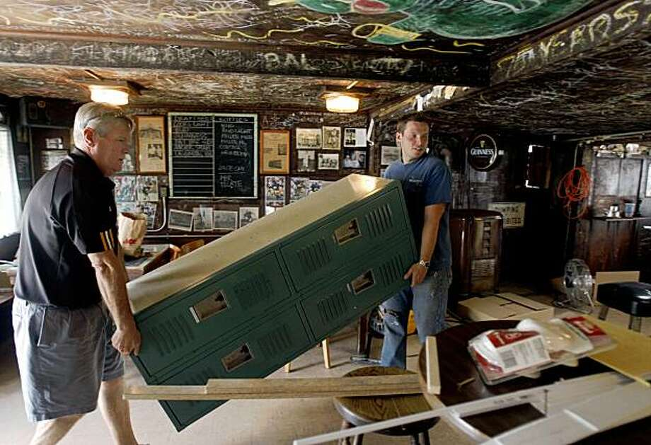 Mike Bowler (left) and his business partner Emil Peinert carry in lockers for employees at the Kingfish Pub in Oakland, Calif., on Wednesday, July 29, 2009. Bowler and Peinert will reopen Oakland's second oldest bar this weekend after it had been closed for over a year. Photo: Paul Chinn, The Chronicle