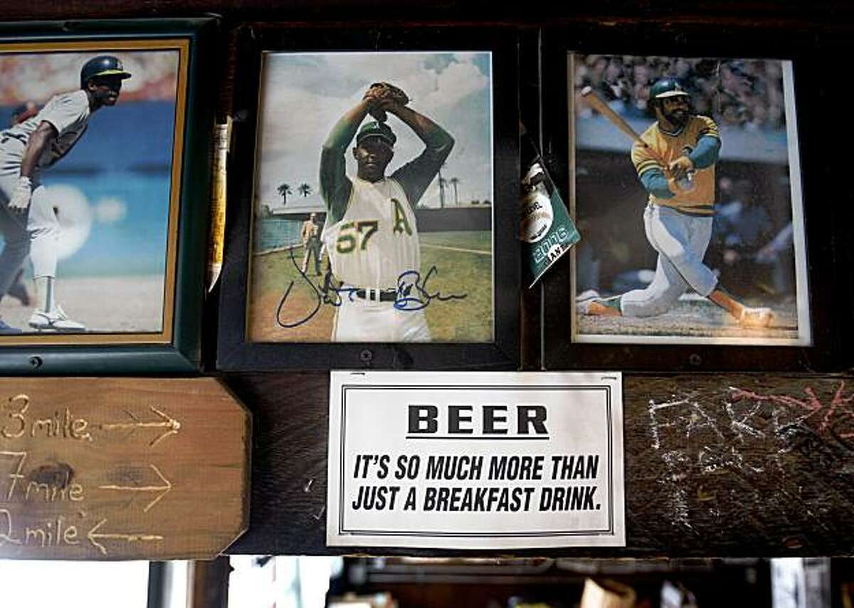 Mementos, some decades old, still adorn the walls and ceiling of the Kingfish Pub in Oakland, Calif., on Wednesday, July 29, 2009. Oakland's second oldest bar will reopen with new management this weekend after it had been closed for over a year.