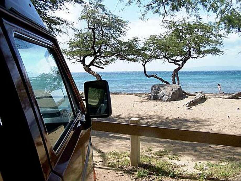 3cd9840c90 A rented Volkswagen Westfalia camper in an ocean-front parking lot on Maui.  A