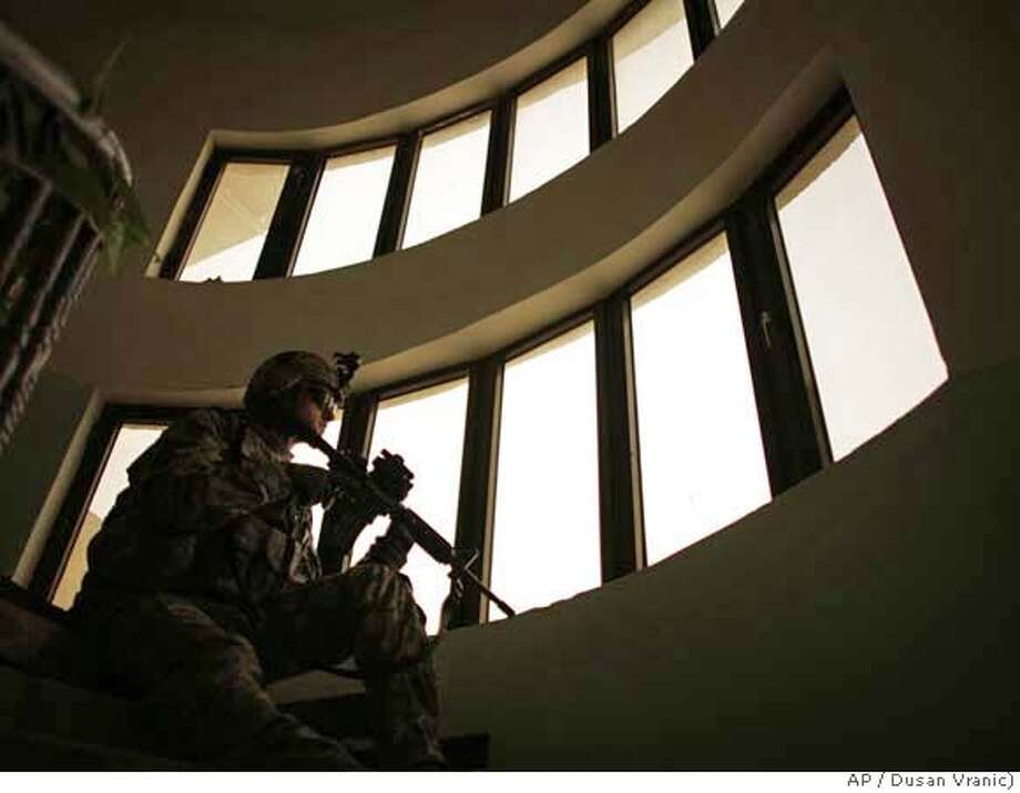 ###Live Caption:A US soldier is on guard at a local council building as Major General Rick Lynch, commander of the Third Infantry Division meets the local leaders in Iskandariyah, 50 kilometers (30 miles) south of Baghdad, Iraq, Saturday, March 15, 2008. (AP photo/Dusan Vranic)###Caption History:A US soldier is on guard at a local council building as Major General Rick Lynch, commander of the Third Infantry Division meets the local leaders in Iskandariyah, 50 kilometers (30 miles) south of Baghdad, Iraq, Saturday, March 15, 2008. (AP photo/Dusan Vranic)###Notes:###Special Instructions: Photo: DUSAN VRANIC