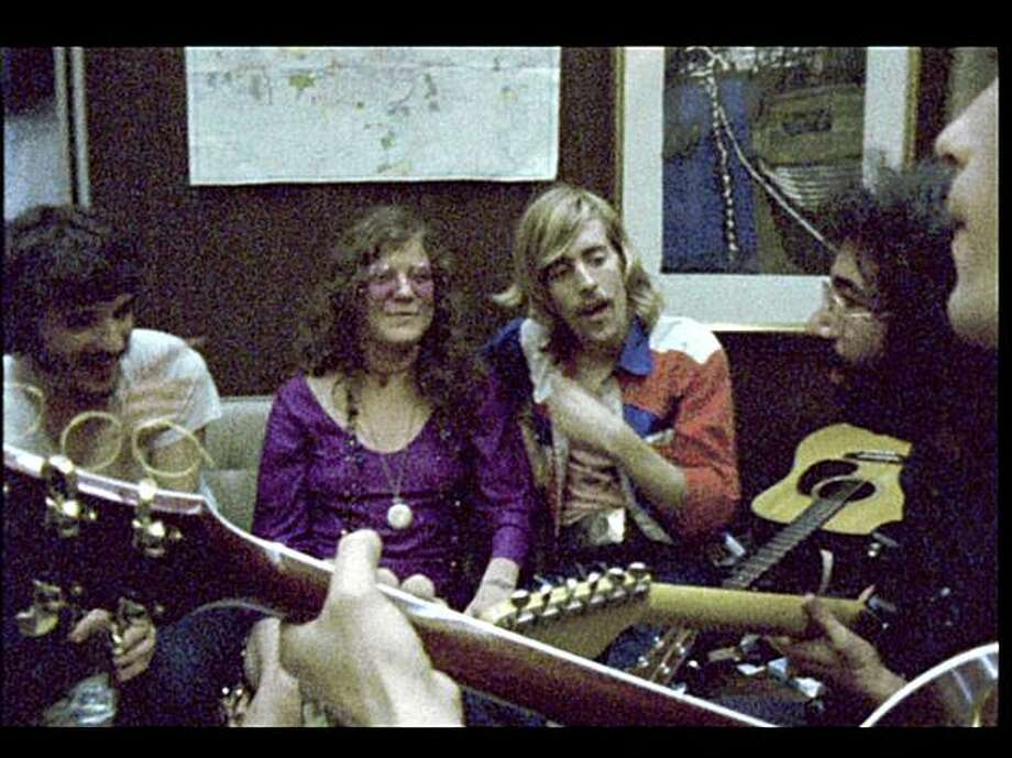 "Rick Danko (from left), Janis Joplin, John ""Marmaduke"" Dawson of the New Riders of the Purple Sage, Jerry Garcia and Bob Weir in ""Festival Express,"" which compiles footage from 1970."