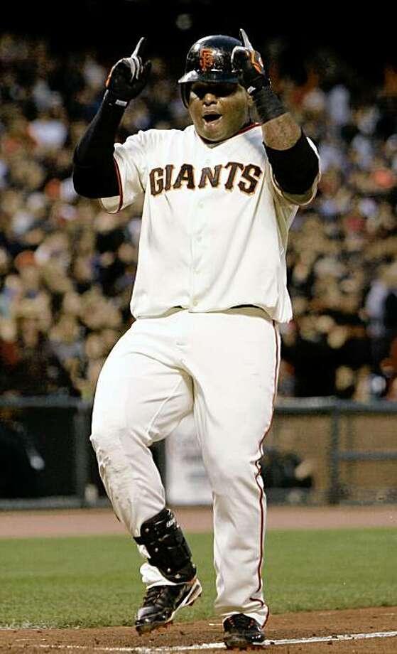 San Francisco Giants' Pablo Sandoval celebrates after hitting a solo home run off of Philadelphia Phillies' Rodrigo Lopez in the third inning of a baseball game in San Francisco, Thursday, July 30, 2009. (AP Photo/Jeff Chiu) Photo: Jeff Chiu, AP