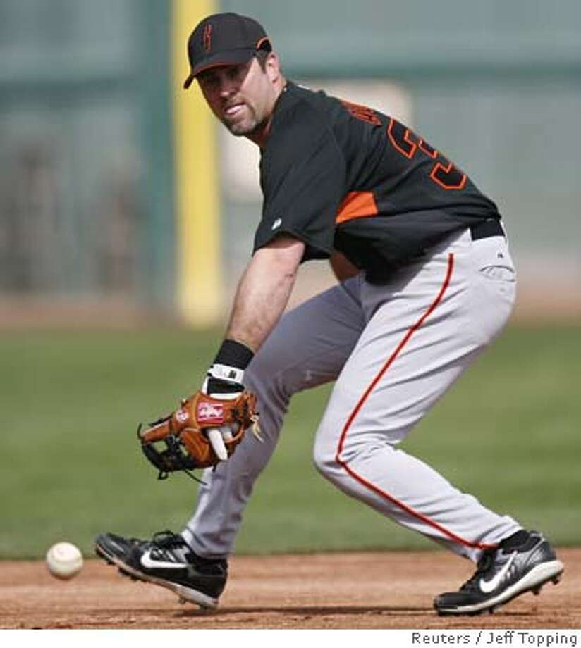 ###Live Caption:San Francisco Giants infielder Rich Aurilia fields a ground ball at the team's baseball spring training camp in Scottsdale, Arizona, February 25, 2008. REUTERS/Jeff Topping (UNITED STATES)###Caption History:San Francisco Giants infielder Rich Aurilia fields a ground ball at the team's baseball spring training camp in Scottsdale, Arizona, February 25, 2008. REUTERS/Jeff Topping (UNITED STATES)###Notes:San Francisco Giants infielder Rich Aurilia fields a ground ball at the team's spring training camp in Scottsdale###Special Instructions: Photo: JEFF TOPPING
