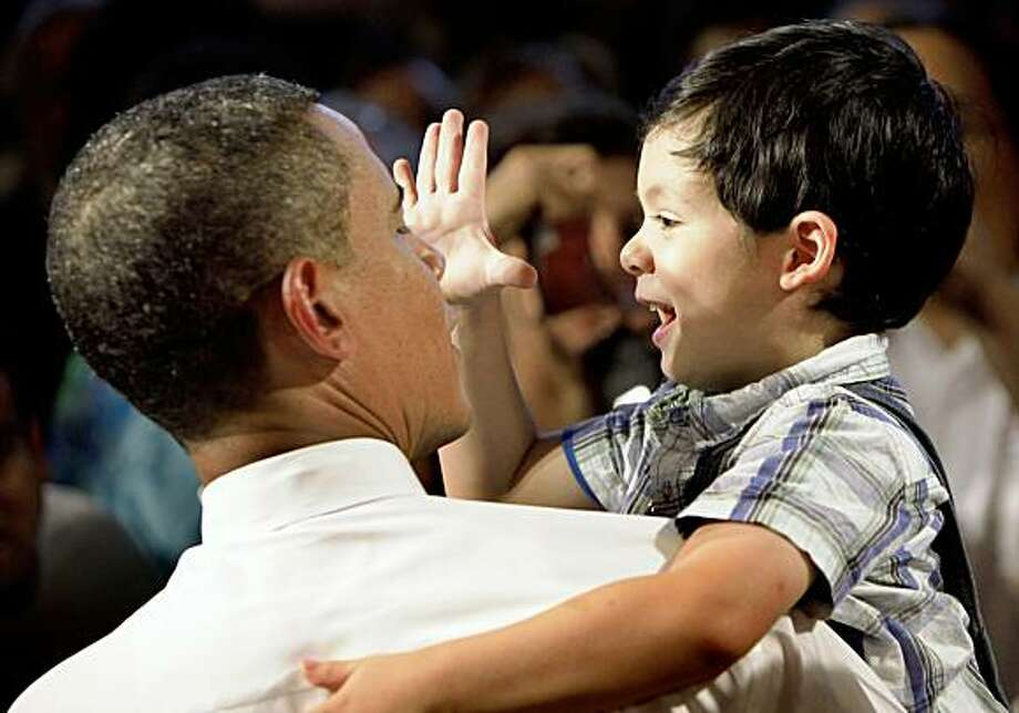 President Barack Obama holds a child following remarks on health care, Thursday, July 23, 2009, at Shaker Heights High School  in Shaker Heights, Ohio. Photo: Haraz N. Ghanbari, Associated Press