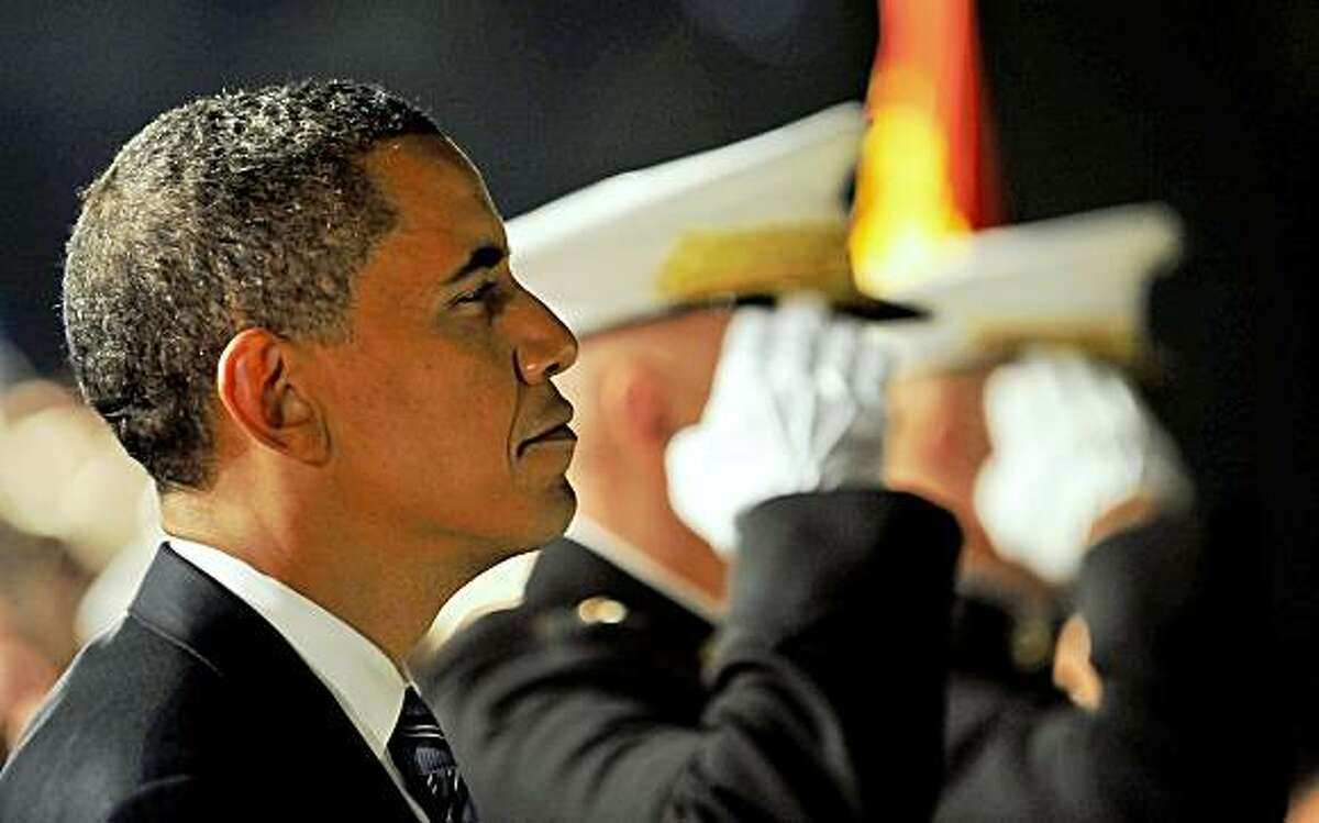 US President Barack Obama (L) reviews the Marine Corps Evening Parade at the Marine Barracks in Washington, DC, on July 24, 2009. AFP PHOTO/Jewel SAMAD (Photo credit should read JEWEL SAMAD/AFP/Getty Images)