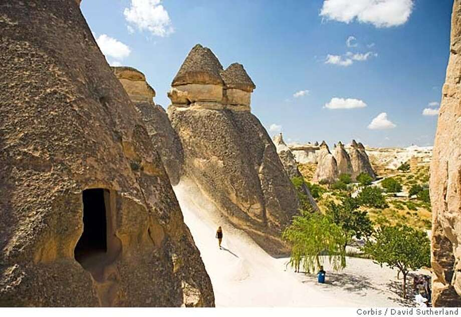 ###Live Caption:Shown here are the Pasabag fairy chimneys in Zelve valley. After the eruption of Mount Erciyes in 253 BC, the lava formed soft rocks in the region of Cappadocia. Wind and water eroded the softer rock, leaving the hard cap rock on top of pillars, which form the present-day fairy chimneys. The pillars have been carved out to form houses, churches and monasteries.###Caption History:Shown here are the Pasabag fairy chimneys in Zelve valley. After the eruption of Mount Erciyes in 253 BC, the lava formed soft rocks in the region of Cappadocia. Wind and water eroded the softer rock, leaving the hard cap rock on top of pillars, which form the present-day fairy chimneys. The pillars have been carved out to form houses, churches and monasteries.###Notes:Fairy Chimneys at Pasabag###Special Instructions:For latest restrictions check www.corbis.com Photo: David Sutherland