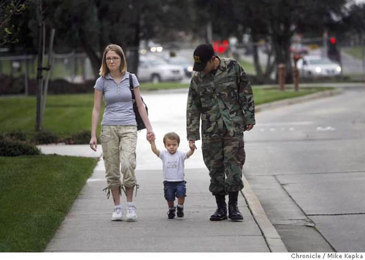###Live Caption:After visiting the Travis Airman and Family Readiness Center at Travis Air Force Base, Ashley Esparza, 21, and husband, Senior Airman, Joshua Esparza, 23, head home with their 18-month-old son Gabriel Esparza in Travis, Calif. on Wednesday March 12, 2008. Esparza says his unit is likely to be deployed for Iraq within the next few months and could be given as little as 12 hours notice before departure. He is worried about what he might miss in his young son's life while being away for several months or longer. Photo by Mike Kepka / San Francisco Chronicle###Caption History:After visiting the Travis Airman and Family Readiness Center at Travis Air Force Base, Ashley Esparza, 21, and husband, Sr. Airman, Joshua Esparza, 23,head home with their 18-month-old son Gabriel Esparza in Travis, Calif. on Wednesday Mar. 12, 2008. Esparza says his unit is likely to be deployed for Iraq within the next few months and could be given as little as 12 hours notice before departure. He is worried about what he might miss in his young son's life while being away for several months or longer. Photo by Mike Kepka / San Francisco Chronicle###Notes:(cq)###Special Instructions:MANDATORY CREDIT FOR PHOTOG AND SAN FRANCISCO CHRONICLE/NO SALES-MAGS OUT