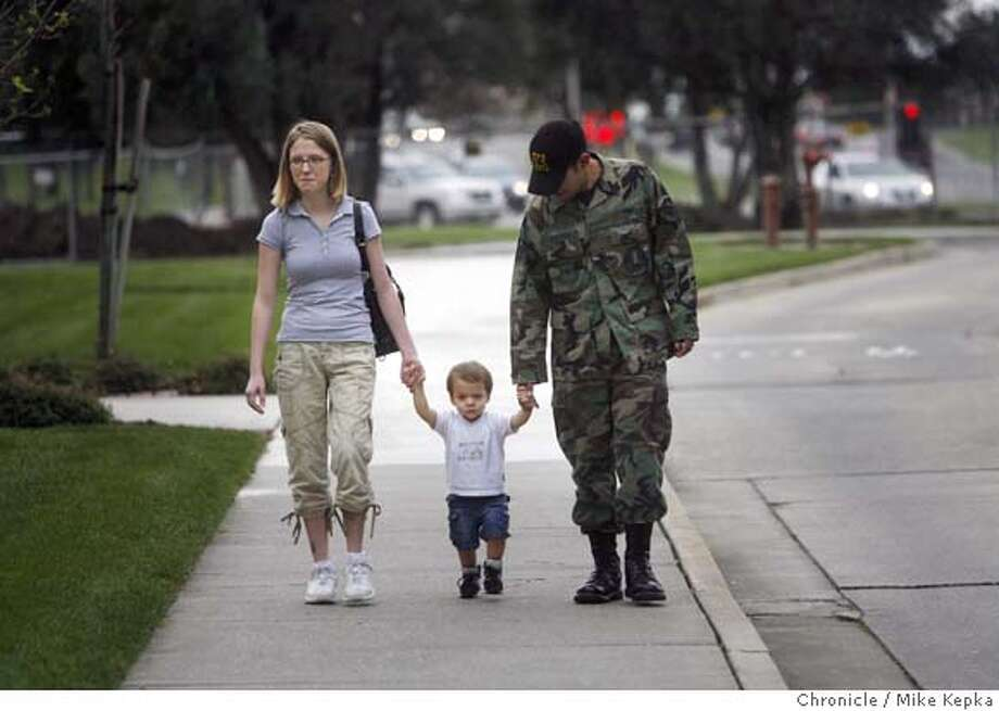 ###Live Caption:After visiting the Travis Airman and Family Readiness Center at Travis Air Force Base, Ashley Esparza, 21, and husband, Senior Airman, Joshua Esparza, 23, head home with their 18-month-old son Gabriel Esparza in Travis, Calif. on Wednesday March 12, 2008. Esparza says his unit is likely to be deployed for Iraq within the next few months and could be given as little as 12 hours notice before departure. He is worried about what he might miss in his young son's life while being away for several months or longer. Photo by Mike Kepka / San Francisco Chronicle###Caption History:After visiting the Travis Airman and Family Readiness Center at Travis Air Force Base, Ashley Esparza, 21, and husband, Sr. Airman, Joshua Esparza, 23,head home with their 18-month-old son Gabriel Esparza in Travis, Calif. on Wednesday Mar. 12, 2008. Esparza says his unit is likely to be deployed for Iraq within the next few months and could be given as little as 12 hours notice before departure. He is worried about what he might miss in his young son's life while being away for several months or longer. Photo by Mike Kepka / San Francisco Chronicle###Notes:(cq)###Special Instructions:MANDATORY CREDIT FOR PHOTOG AND SAN FRANCISCO CHRONICLE/NO SALES-MAGS OUT Photo: Mike Kepka