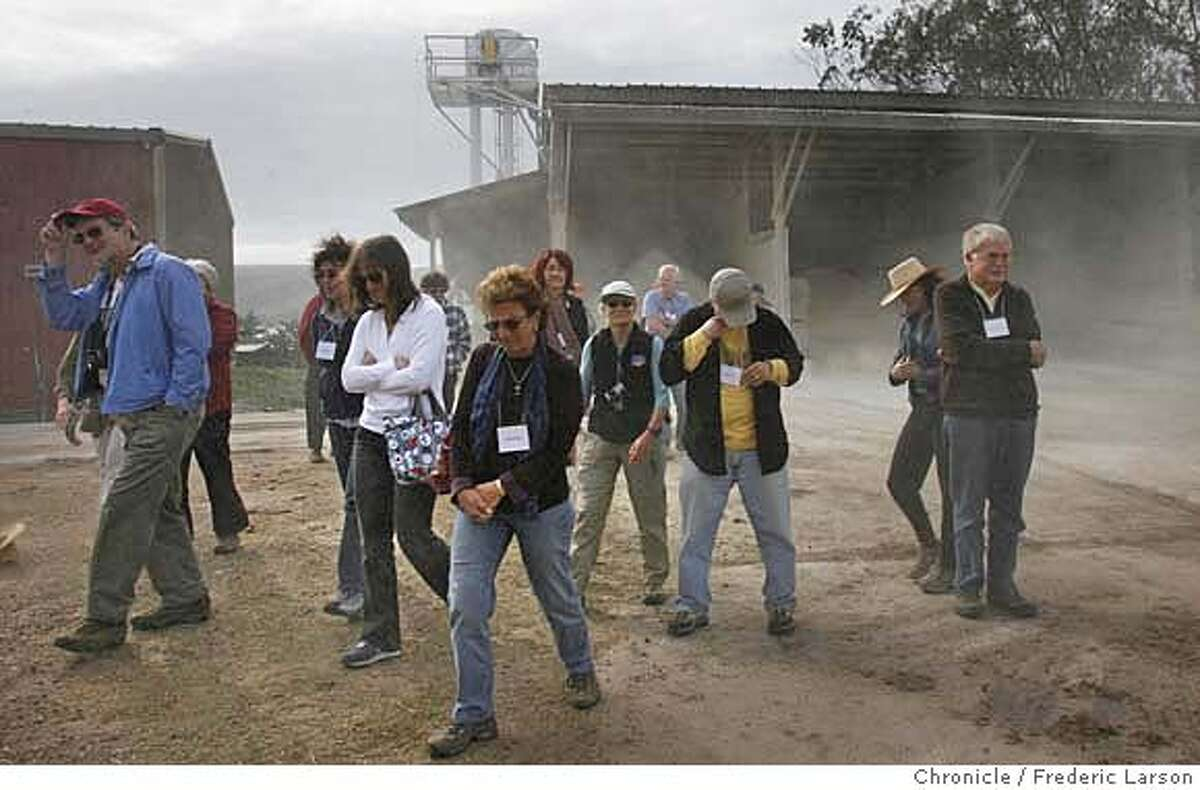 ###Live Caption:A group of environmentalists on a field trip to Straus Organic Family Creamery in Marshall, Calif., got caught in a mini dust storm while on a private tour of the dairy on Friday, March 7, 2008. The three-day conference celebrates the writings of the late Wallace Stegner. Photo by Frederic Larson / San Francisco Chronicle###Caption History:A group of environmentalist on a field trip to Straus Organic Family 3/7 Creamery in Marshall California got caught in a mini dust storm while on a private tour of the dairy. The central themes of the weekend's three-day conference celebrating the writings of the late Stegner, where they spend time in the forestlands of West Marin on Friday 3/7 with some of the renowned authors and historians. 3/7/08. {Photo by Frederic Larson / San Francisco Chronicle}###Notes:Toby's Feed Barn, right downtown; Pt. Reyes Station is on Highway 1 in West Marin.###Special Instructions:MANDATORY CREDIT FOR PHOTOG AND SAN FRANCISCO CHRONICLE/NO SALES-MAGS OUT