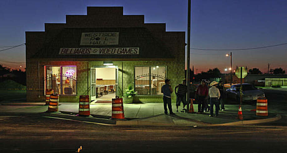 After a day of work for some and none for others, men gather at the local pool hall on the evening of Tuesday June 30, 2009, in Mendota, Calif. Photo: Michael Macor, The Chronicle