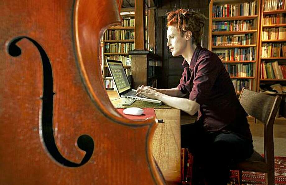 "Zoe Keating has over 700,000 followers on her Twitter page. Keating, a musician by trade, with her Cello, ""Arierge""at her home in Camp Meeker, Calif., on Saturday July 11, 2009. Photo: Michael Macor, The Chronicle"