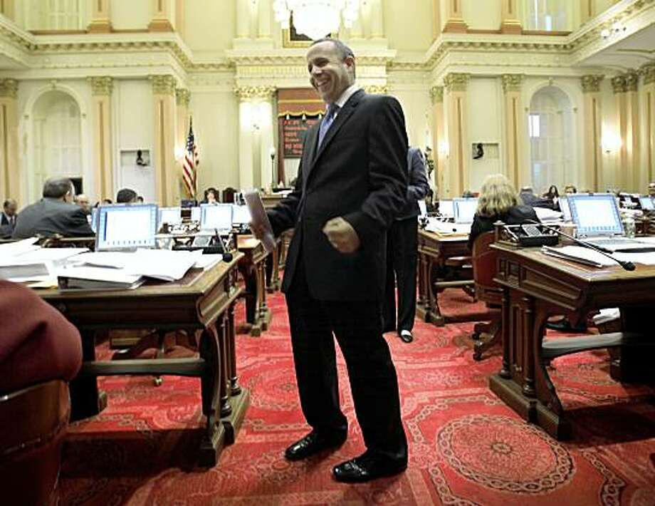 State Senate President Pro Tem Darrell Steinberg, D-Sacramento, celebrates after the Senate approved the last of a package of 31 bills to close California's $26 billion budget deficit, at the Capitol in Sacramento, Calif., Friday, July 24, 2009. Photo: Rich Pedroncelli, Associated Press