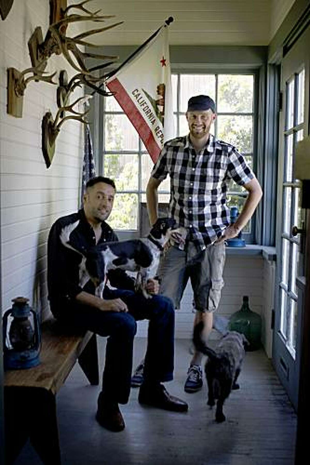 Photo stylist Rod Hipskind (right) and candy maker David Williams (left) at home with Henry (right) and Gus (left) in San Francisco, Calif., on Tuesday, July 14, 2009.