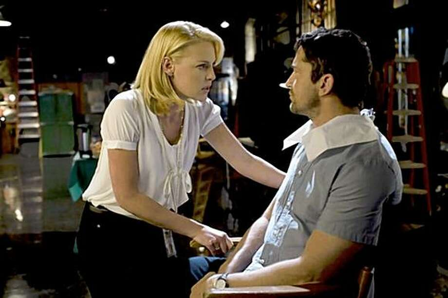 """The Ugly Truth."" Katherine Heigl and Gerard Butler star in Columbia Pictures' comedy THE UGLY TRUTH. Photo:  Saeed Adyani/Columbia Pictures"