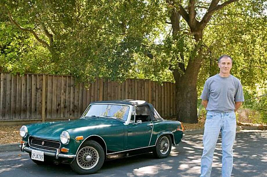 """Richard Haas bought this 1969 MG Midget after spotting it at a gas station, where it had been taken after being repossessed. """"It looked pretty ratty,"""" he says, """"but it was all there, down to the tonneau cover and ripped ragtop."""" Photo: Rachel Styer"""
