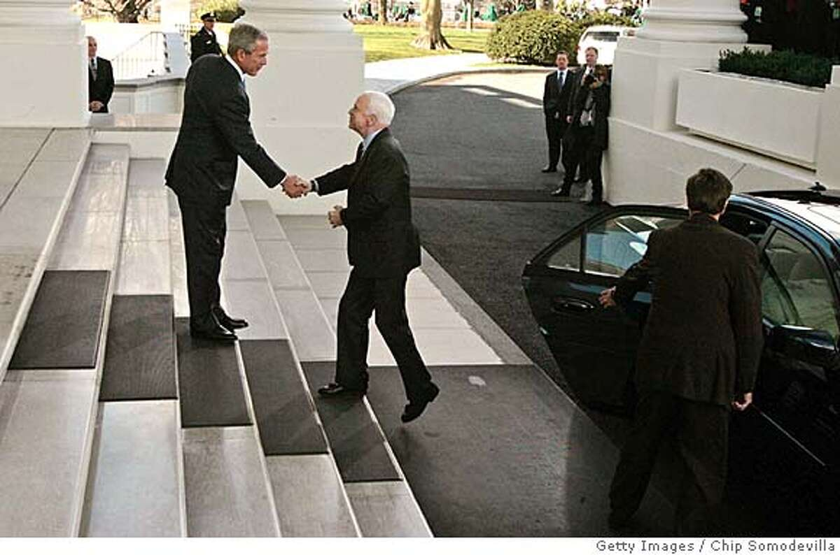 WASHINGTON - MARCH 05: U.S. President George W. Bush (L) welcomes the Republican presidential nominee Sen. John McCain (R-AZ) to the White House March 5, 2008 in Washington, DC. Bush will announce his endorsement of McCain for the GOP nomination in the Rose Garden after a private lunch. McCain reached the required 1,191 delegates necessary to clinch the nomination after Tuesday primaries in Ohio, Texas, Vermont and Rhode Island put him over the top. (Photo by Chip Somodevilla/Getty Images) Ran on: 03-09-2008 President Bush welcomes presidential nominee John McCain to the White House on Wednesday. Ran on: 03-09-2008 Ran on: 03-09-2008