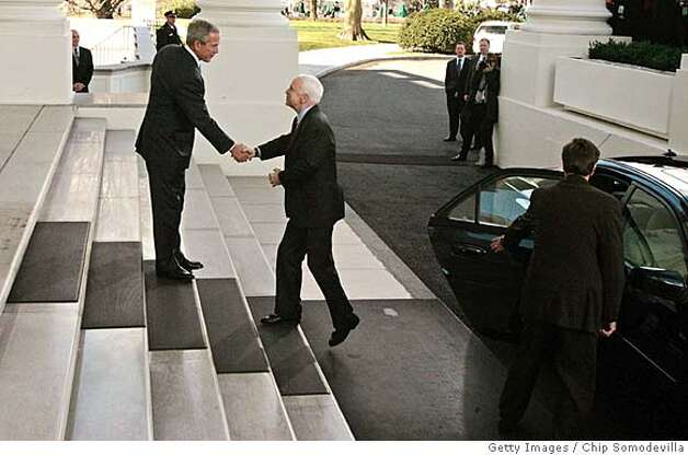 WASHINGTON - MARCH 05: U.S. President George W. Bush (L) welcomes the Republican presidential nominee Sen. John McCain (R-AZ) to the White House March 5, 2008 in Washington, DC. Bush will announce his endorsement of McCain for the GOP nomination in the Rose Garden after a private lunch. McCain reached the required 1,191 delegates necessary to clinch the nomination after Tuesday primaries in Ohio, Texas, Vermont and Rhode Island put him over the top. (Photo by Chip Somodevilla/Getty Images)  Ran on: 03-09-2008  President Bush welcomes presidential nominee John McCain to the White House on Wednesday.  Ran on: 03-09-2008 Ran on: 03-09-2008 Photo: Chip Somodevilla