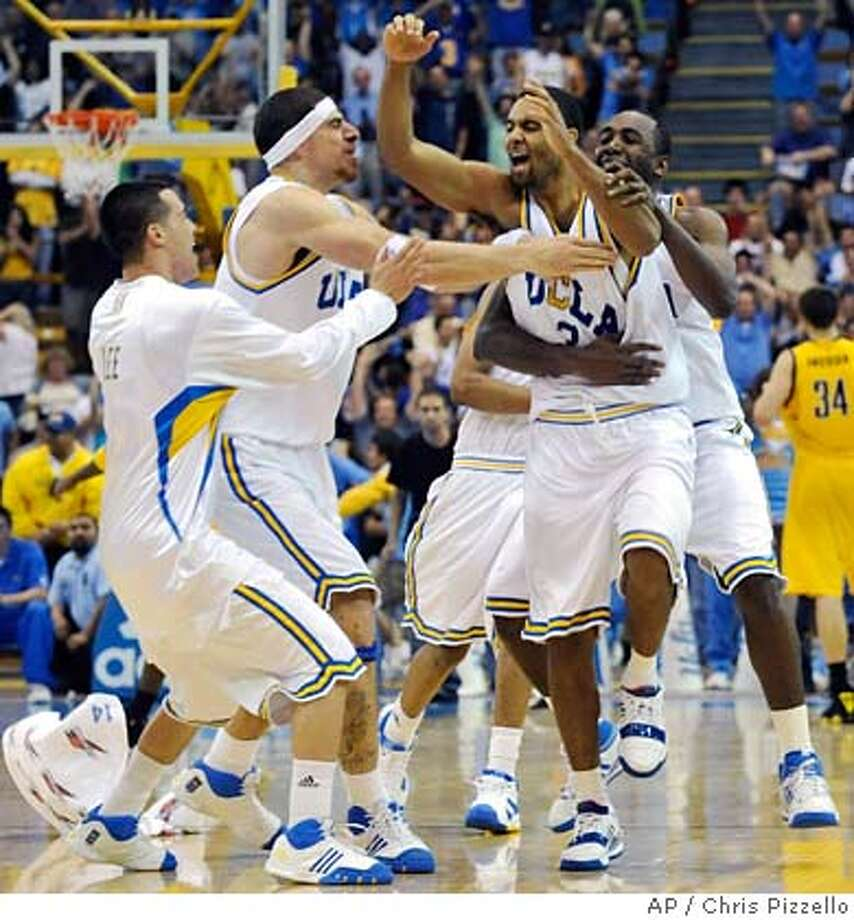 ###Live Caption:UCLA's Josh Shipp, second from right, is mobbed by teammates, from left, Matt Lee, Lorenzo Mata-Real and Luc Richard Mbah a Moute, after his last-second shot defeated California 81-80 in a basketball game in Los Angeles, Saturday, March 8, 2008. (AP Photo/Chris Pizzello)###Caption History:UCLA's Josh Shipp, second from right, is mobbed by teammates, from left, Matt Lee, Lorenzo Mata-Real and Luc Richard Mbah a Moute, after his last-second shot defeated California 81-80 in a basketball game in Los Angeles, Saturday, March 8, 2008. (AP Photo/Chris Pizzello)###Notes:Josh Shipp, Luc Richard Mbah a Moute, Matt Lee, Lorenza Mata-Real###Special Instructions:EFE OUT Photo: Chris Pizzello
