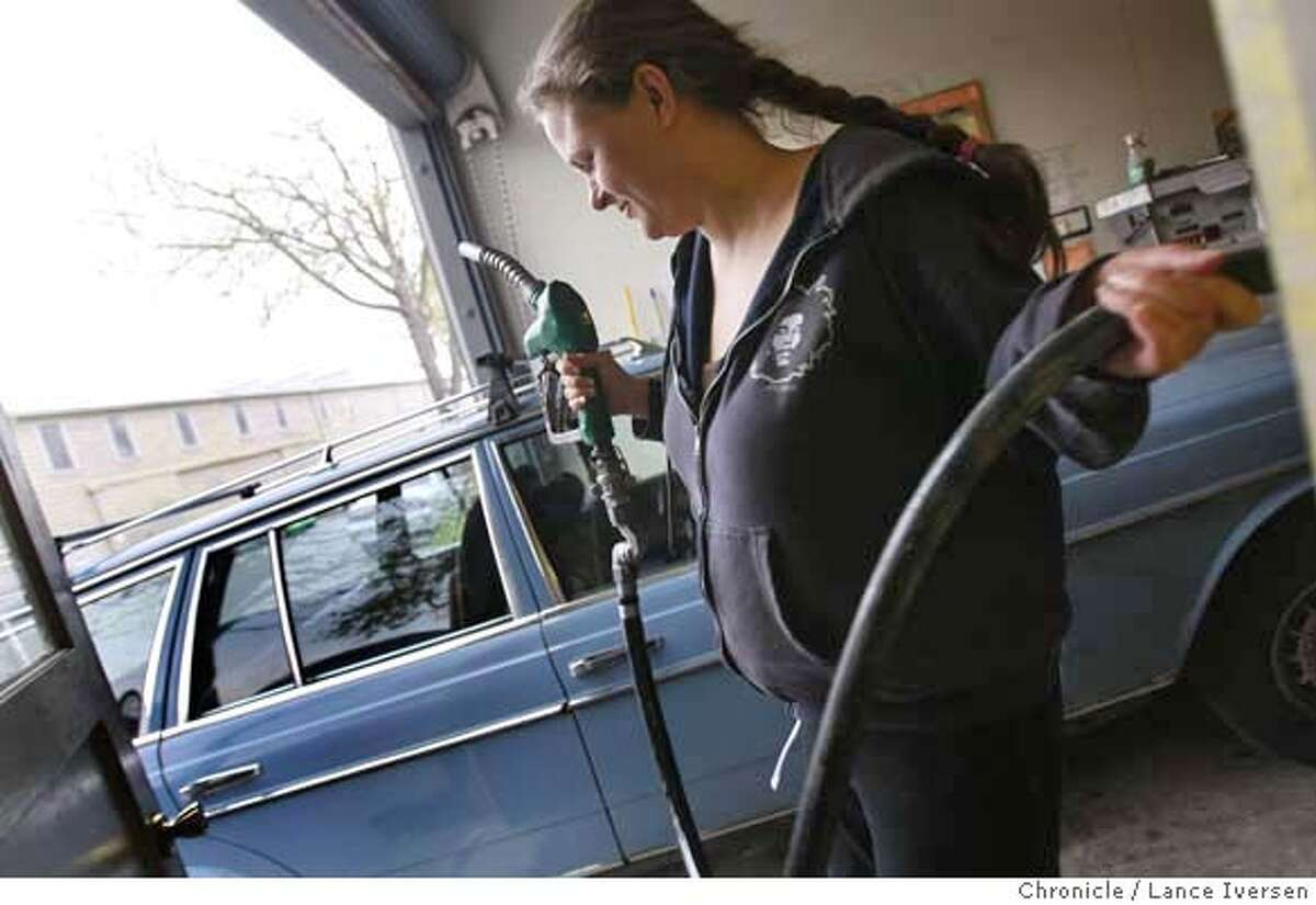 Mika Zelie from Oakland Calif prepares to fuel up at Bio Fuel Oasis at 2465 Fourth St in Berkeley, Calif., Tuesday March 11, 2008. Zelie has been a Bio Fuel consumer for the past four years, with very little invested in converting her Mercedes engine to accept the vegetable oil based fuel. Photo By Lance Iversen / San Francisco Chronicle. Ran on: 03-12-2008 Mika Zelie of Oakland fuels up at BioFuel Oasis in Berkeley, where she has been a customer for four years.