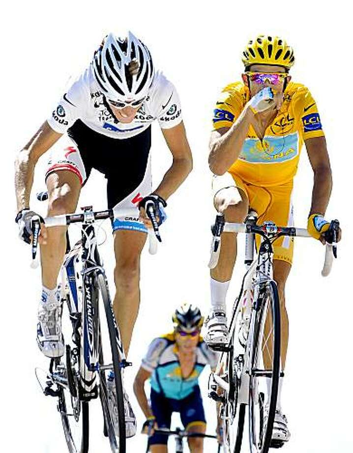 MONT VENTOUX, FRANCE - JULY 25:  Race leader Alberto Contador (R) of Spain and team Astana crosses the finishline flanked by Andy Schleck (L) of Luxembourg and team Saxo Bank and backdropped by his teammate Lance Armstrong of USA at the end of stage 20 from Montelimar to Mont Ventoux on July 25, 2009 on Mont Ventoux, France.   (Photo by Jasper Juinen/Getty Images) Photo: Jasper Juinen, Getty Images