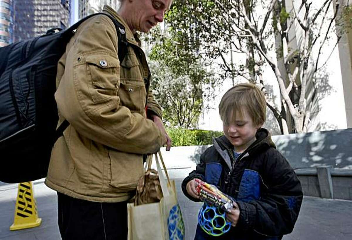 Gavin retrieves crayons out of Toni, his mother, backpack, on May 21, 2009, along Market Street in San Francisco, Calif.