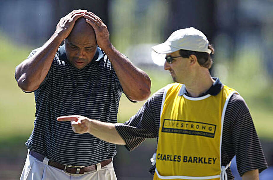 Charles Barkley, basketball Hall of Famer, NBA broadcaster, sometimes-clown prince and notorious bad golfer, takes advise from his caddie San Francisco Chronicle golf writer/columnist Ron Kroichick at the 20th annual Celebrity Pro-Am American Century Championship at Edgewood Tahoe Golf Course. Thursday July 16, 2009 Photo: Lance Iversen, The Chronicle