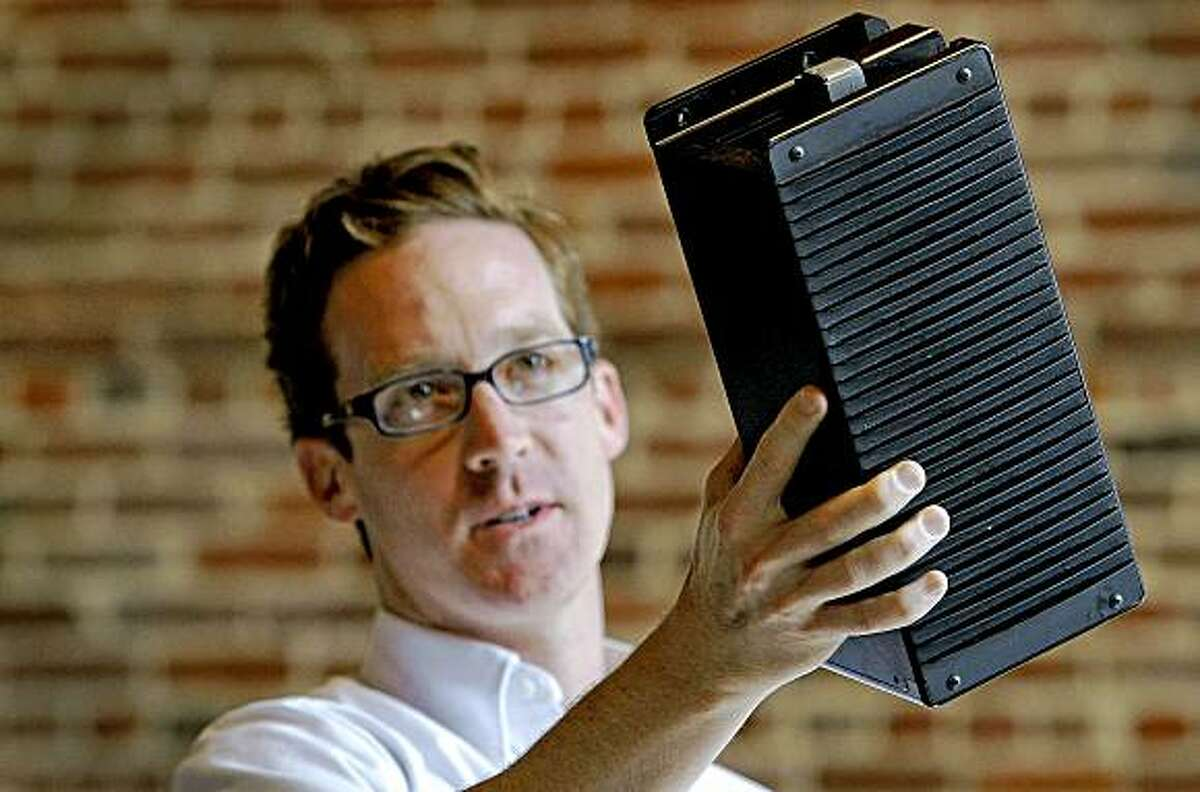 Co-founder, Mason Cabot of Mission Motors of San Francisco, Calif. on Friday July 10, 2009, holds one of the batteries that powers an electric powered