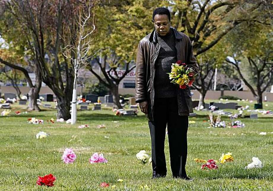Brian Copeland, visits the grave of his grandmother, at the Holy Sepluchre Cemetery in Hayward, Calif. on Tuesday Mar. 17, 2009. His mother who passed away in 1979 is also buried in the same plot. Photo: Michael Macor, The Chronicle
