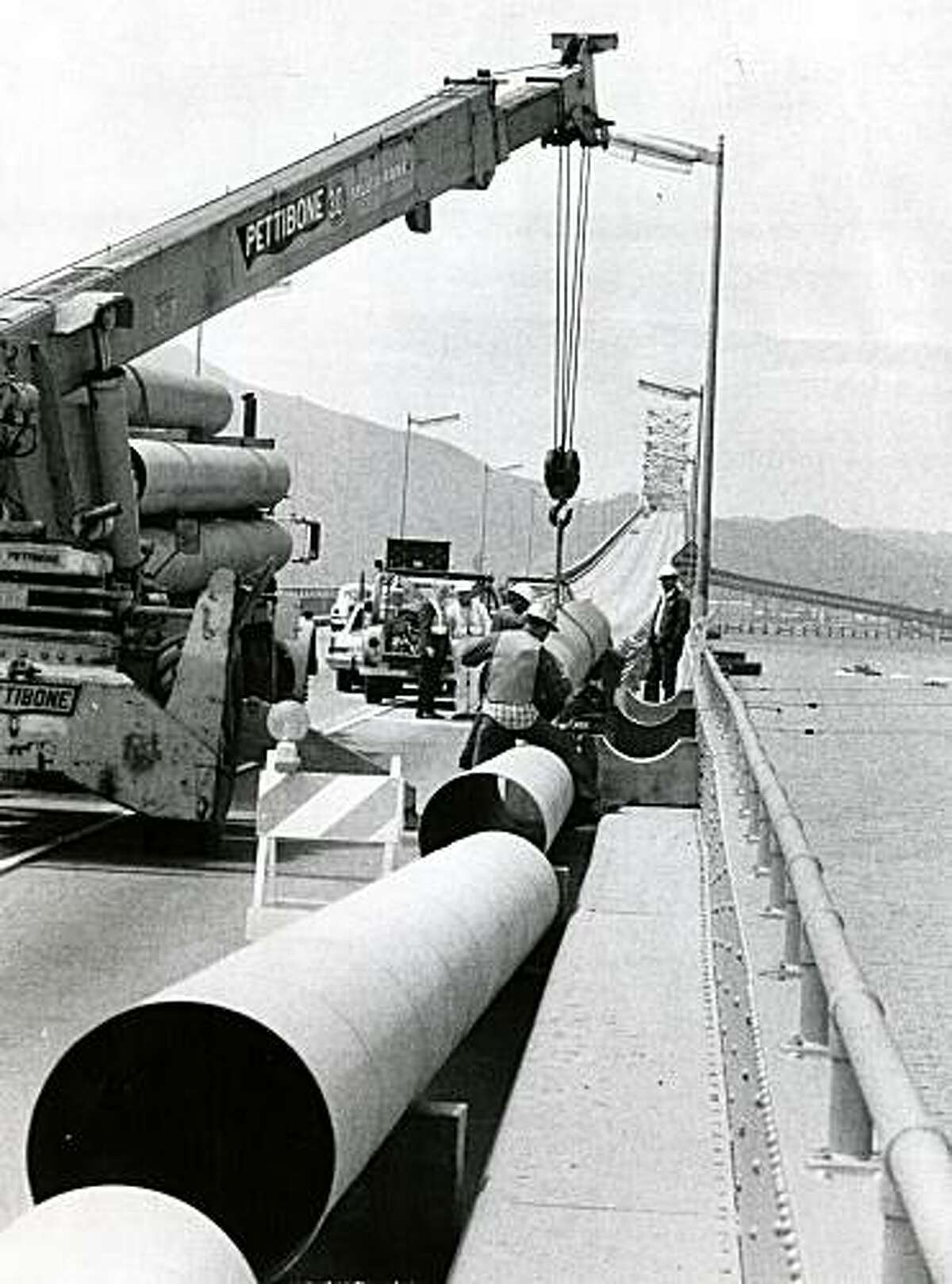 Marin Municipal Water District workers build a water pipe on May 3, 1977 on the Richmond-San Rafael Bridge. The pipe supplied emergency water from EBMUD to MMWD during particularly dry year throughout California.