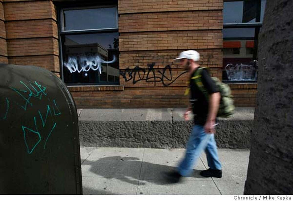 ###Live Caption:Not from his home, Cameron MacMillan walks past the graffiti marked walls of 165 10th Street on Tuesday, Mar. 11, 2008 in San Francisco, Calif. MacMillian says often likes the artistic qualities of the graffiti and feels it may even create jobs for people who have to clean it up. Photo by Mike Kepka / San Francisco Chronicle###Caption History:Not from his home, Cameron MacMillan walks past the graffiti marked walls of 165 10th Street on Tuesday, Mar. 11, 2008 in San Francisco, Calif. MacMillian says often likes the artistic qualities of the graffiti and feels it may even create jobs for people who have to clean it up. Photo by Mike Kepka / San Francisco Chronicle###Notes:(cq) Cameron Mac Millan 415 368-9297###Special Instructions:MANDATORY CREDIT FOR PHOTOG AND SAN FRANCISCO CHRONICLE/NO SALES-MAGS OUT