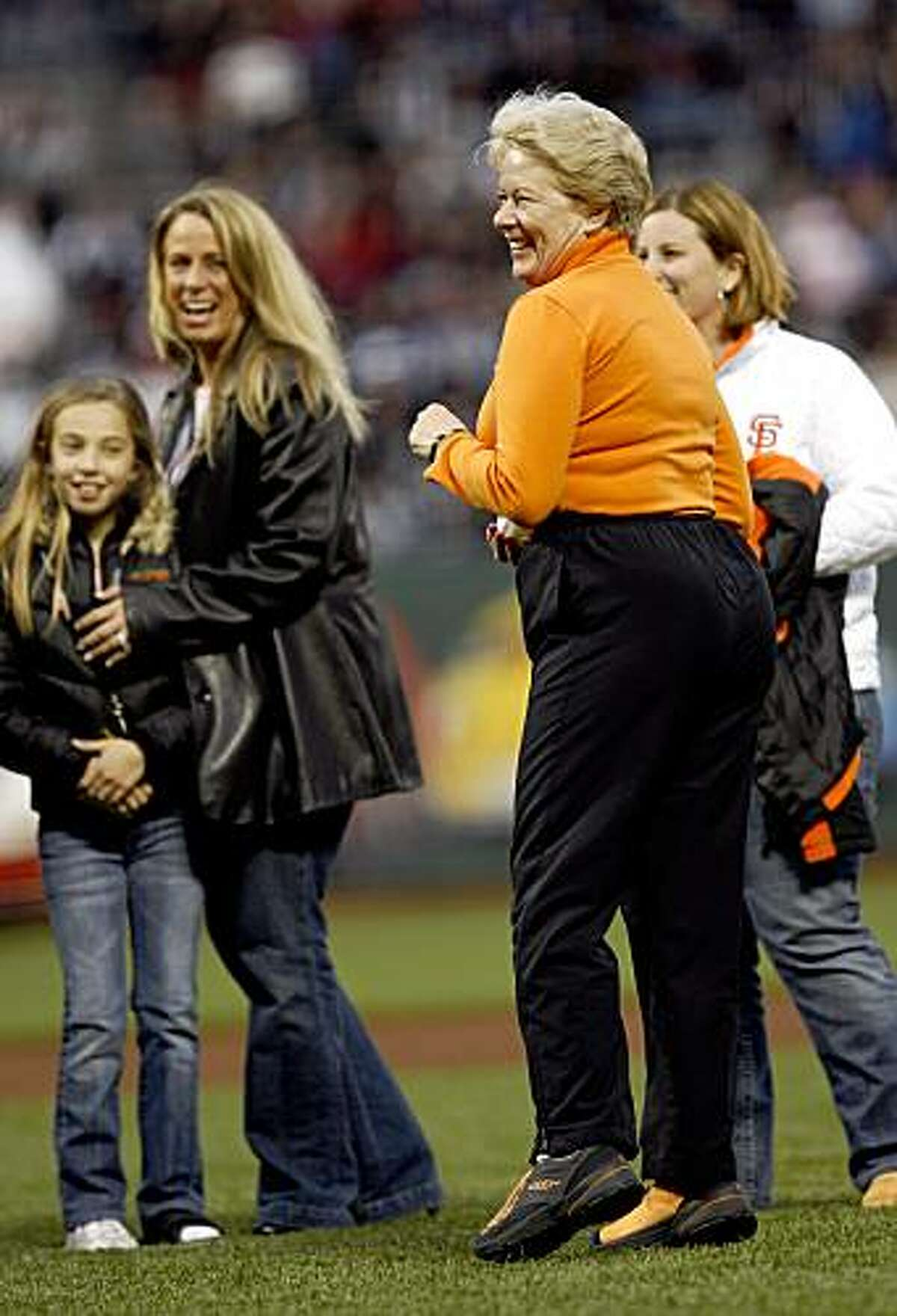 In this April 4, 2007, photo, San Francisco Giants' owner Sue Burns prepares to throw the first pitch in honor of her late husband, Harmon Burns, who had died the previous year, at a baseball game in San Francisco, Calif. Sue Burns, a part owner of the Giants, died late Saturday, July 18, 2009. Burns, 58, died of complications from cancer, team spokesman Jim Moorehead said Sunday.