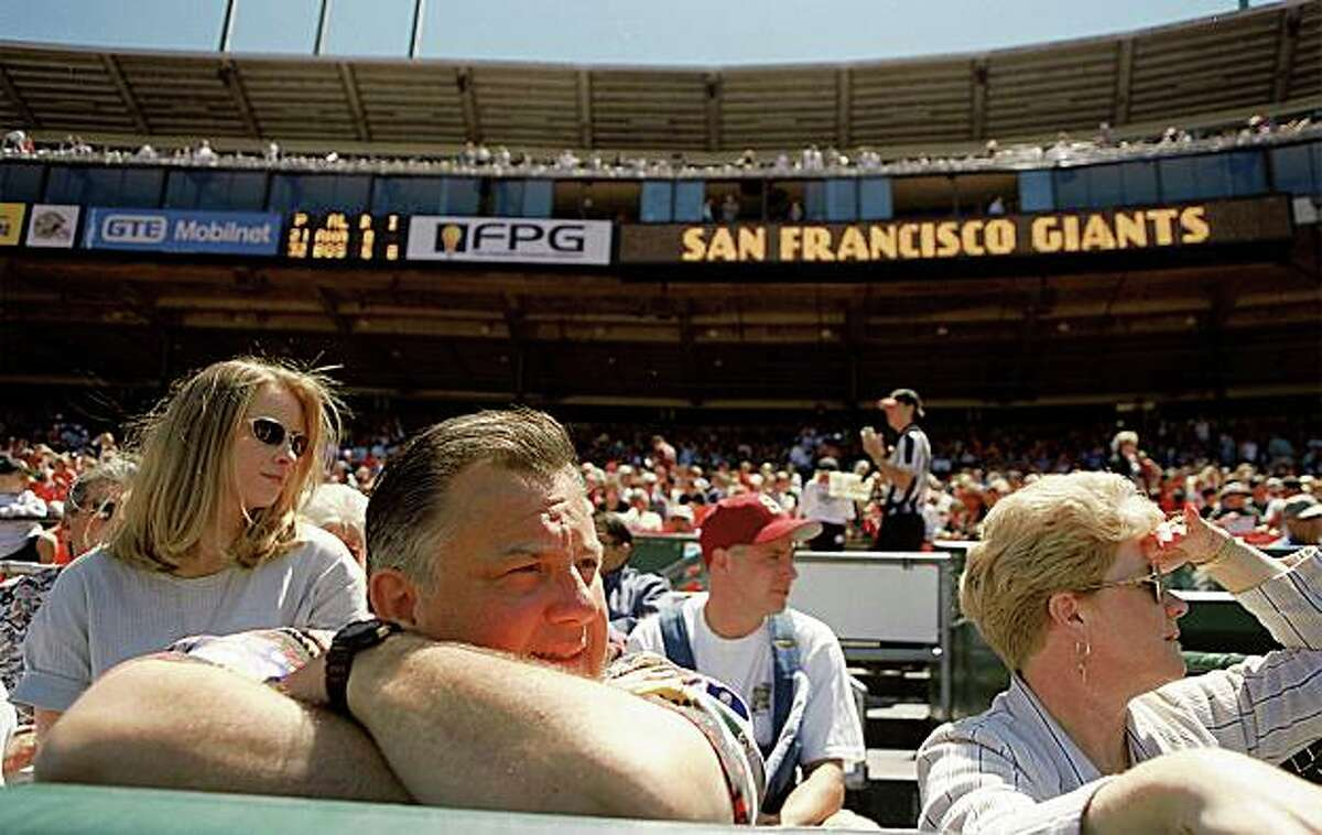 In an August 1998 photo, San Francisco Giants owners Harmon Burns, front left, and his wife, Sue Burns, right, attend a Giants baseball game with daughter Trina Dean, left, in San Francisco. Sue Burns, who was close friends Bonds, died late Saturday, July 18, 2009. Burns, 58, died of complications from cancer, team spokesman Jim Moorehead said Sunday. Harmon Burns died in 2006. (AP Photo/San Francisco Chronicle, Tim Kao) ** MANDATORY CREDIT MAGS OUT NO SALES **