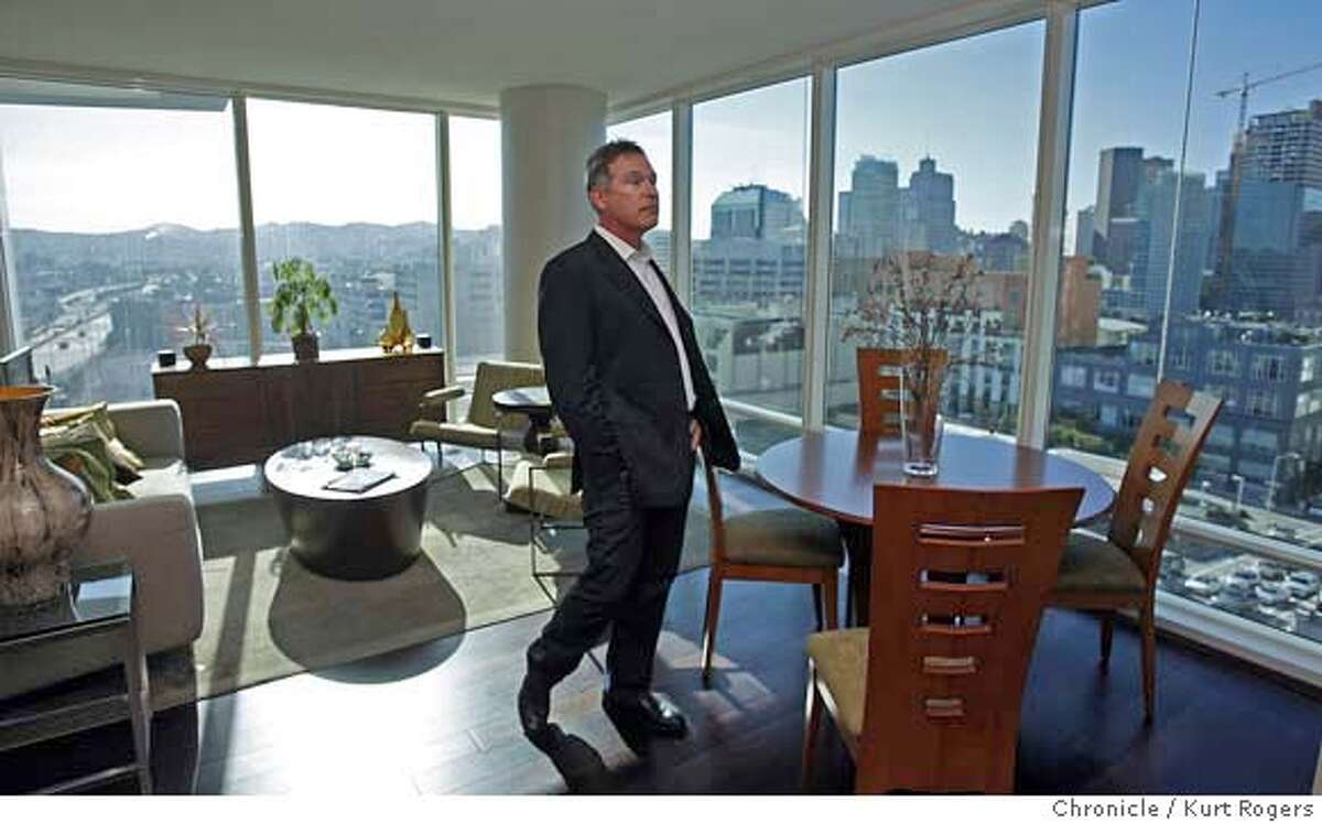 ###Live Caption:One Rincon at 425 first street has its first tenants. Mike Machado standing in the living room of his new condo. He just moved in and loves the views of San Francisco he is one of the first 25 to move in. on March 4,2008. Photo By Kurt Rogers / San Francisco Chronicle###Caption History:One Rincon at 425 first street has its first tenants. Mike Machado standing in the living room of his new condo. He just moved in and loves the views of San Francisco he is one of the first 25 to move in. on March 4,2008. Photo By Kurt Rogers / San Francisco Chronicle###Notes:One rincon 425 first st.###Special Instructions:MANDATORY CREDIT FOR PHOTOG AND SAN FRANCISCO CHRONICLE/NO SALES-MAGS OUT