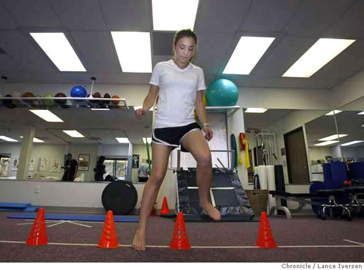 ###Live Caption:Nicole Simon age 15 from Oakland injured both knees, first in Soccer then Basketball that required surgery performs lateral cone drills to help strengthen her knees. Simon is now enrolled in a physical Therapy program with Bruce Valentine a certified Athletic Trainer at the new Sports Medicine Center for Young Athletes at Children's Hospital. Photo taken on Thursday March 6, 2008. Photo by Lance Iversen / San Francisco Chronicle###Caption History:Nicole Simon age 15 from Oakland injured both knees, first in Soccer then Basketball that required surgery performs lateral cone drills to help strengthen her knees. Simon is now enrolled in a physical Therapy program with Bruce Valentine a certified Athletic Trainer at the new Sports Medicine Center for Young Athletes at Children's Hospital. Photo taken on Thursday March 6, 2008. Photo by Lance Iversen / San Francisco Chronicle###Notes:Lance Iversen 415-2979395###Special Instructions:MANDATORY CREDIT PHOTOG AND SAN FRANCISCO CHRONICLE.