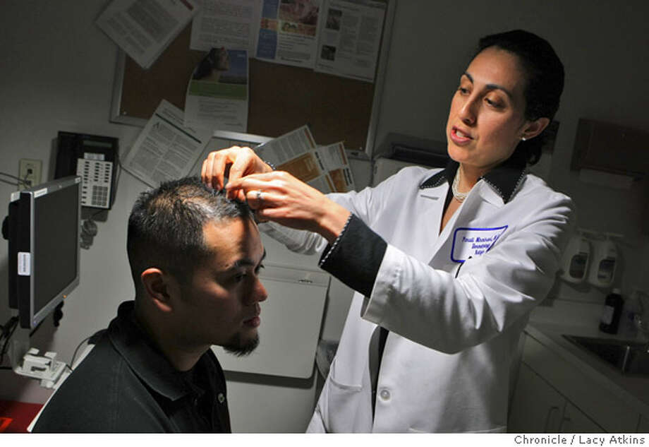 Dr. Paradi Mirmirani examines Darrell Madarang hair growth on his follow up visit, Thursday March 6, 2008 at Kaiser Permanente in Vallejo, Ca. Madarang started being treated for baldness in June and in September people noticed that he was starting to develop a fuller head of hair.  Photo by Lacy Atkins / San Francisco Chronicle Photo: Lacy Atkins