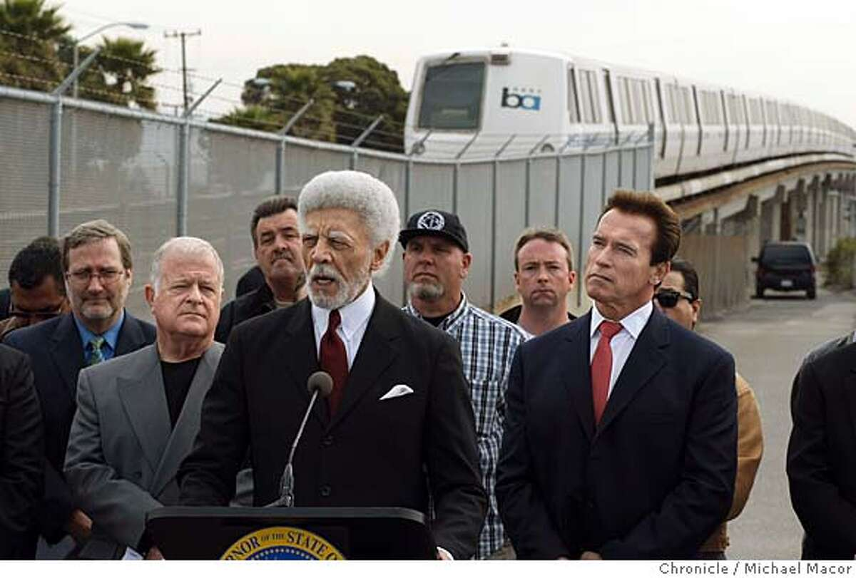 Oakland Mayor Ron Dellums is joined by Senate President Pro Tem, Don Perata, left and California Governor Arnold Schwarzenegger, right, stand at the West Portal of the BART system, in Oakland, Calif., on Mar. 7,2008, to annonce that BART and other state agencies are about to receive millions of dollars from the 2008 installment from voter approved Proposition 1B funds, which enacted the Highway Safety, Traffic Reduction, Air Quality, and Port Security Bond Act of 2006. Photo by Michael Macor/ San Francisco Chronicle